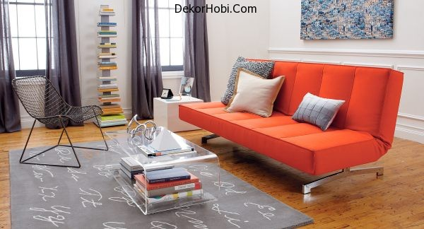A-bright-orange-sleeper-sofa-in-a-modern-living-room