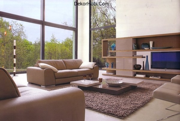 A-contemporary-living-room-with-a-large-shelving-unit