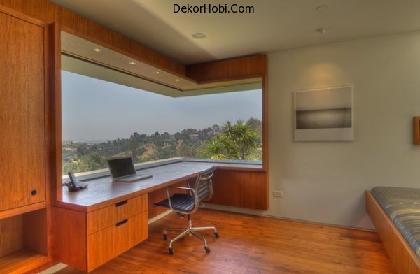 Panoramic-window-gives-this-home-office-a-great-view-of-the-outdoors