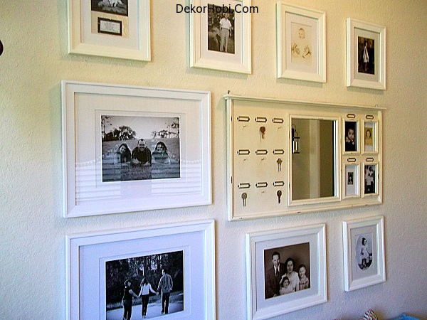wall-gallery-of-familiy-pictures-with-white-frames