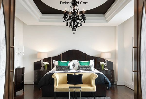 Luxury-bedroom-with-emerald-pillows-to-balance-the-neutral-black-and-white