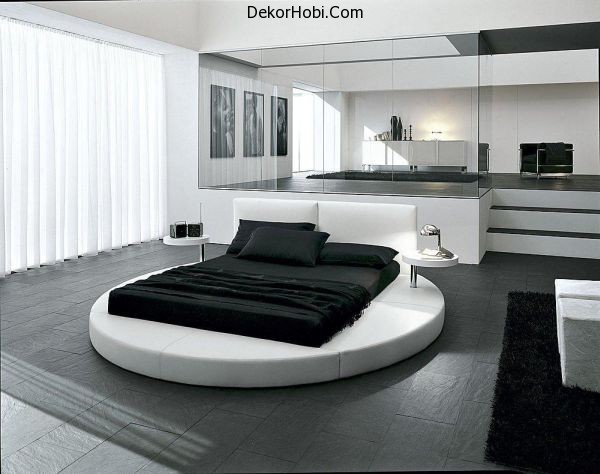 Sophisticated-contemporary-bedroom-with-ergonomic-round-bed-at-its-heart