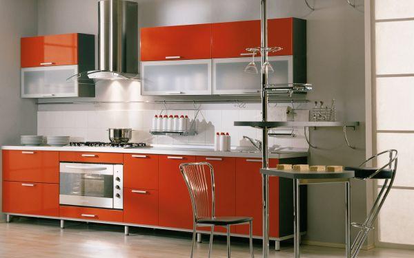 Orange-modern-kitchen-with-stylish-glass-cabinets