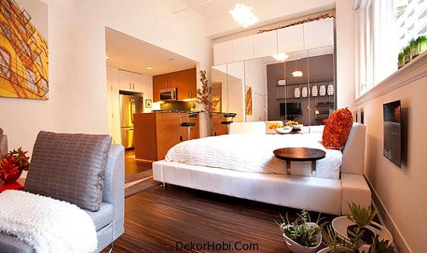Mirrored-closet-doors-in-a-compact-bedroom