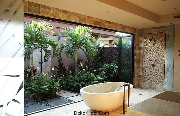 Tropical-foliage-bring-the-outdoors-into-this-modern-bathroom